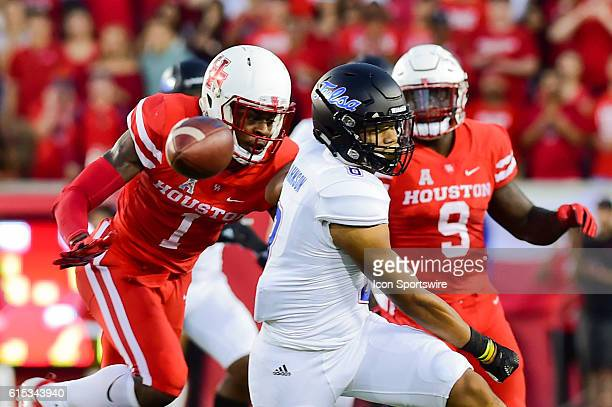 Tulsa Golden Hurricane running back Keenen Johnson looks for a pass as Houston Cougars saftey Garrett Davis defends during the Tulsa Golden...