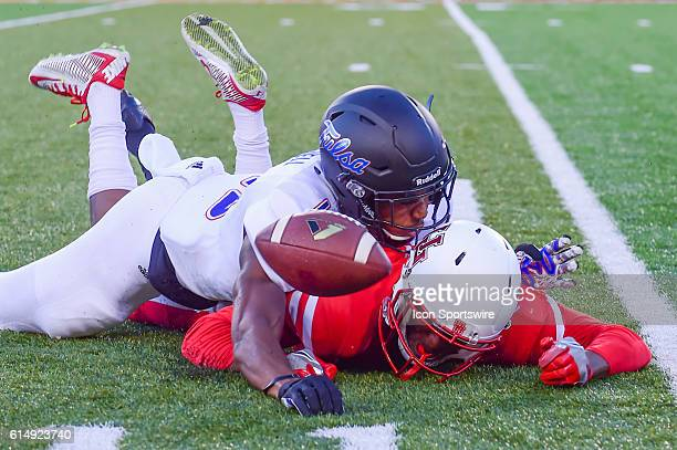 Tulsa Golden Hurricane safety Jordan Mitchell breaks up a pass play intended for Houston Cougars wide receiver Chance Allen during the Tulsa Golden...