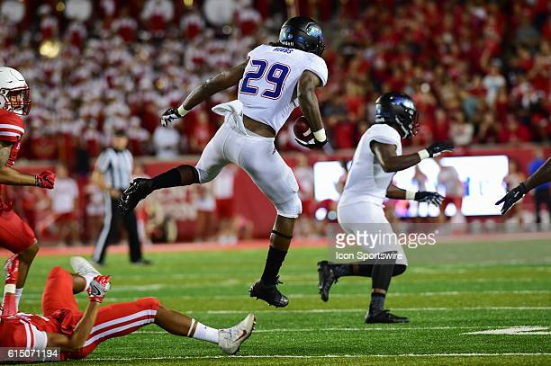 Tulsa Golden Hurricane wide receiver Justin Hobbs hurdles a downed Cougar during the Tulsa Golden Hurricanes at Houston Cougars game at TDECU...