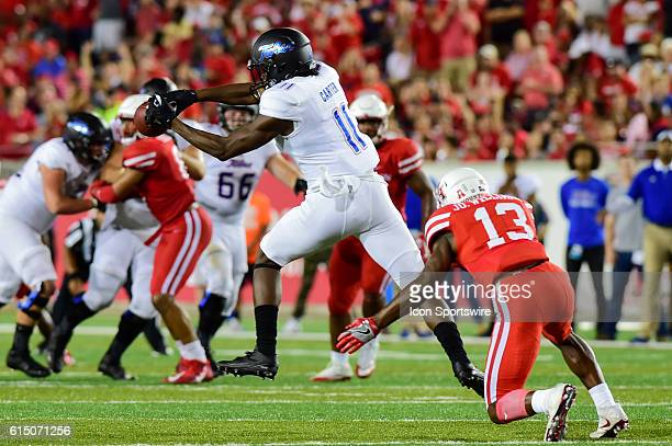 Tulsa Golden Hurricane wide receiver Nigel Carter attempts to make a catch over the middle as Houston Cougars cornerback Joeal Williams defends...