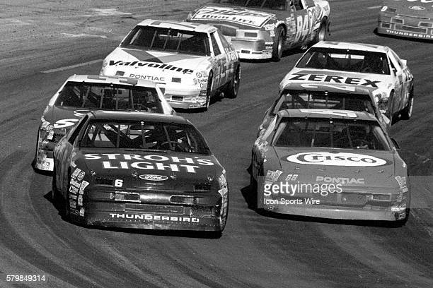 Mark Martin Roush Racing Ford Thunderbird leads the Holly Farms 400 NASCAR Winston Cup series event North Wilkesboro Speedway in North Wilkesboro...