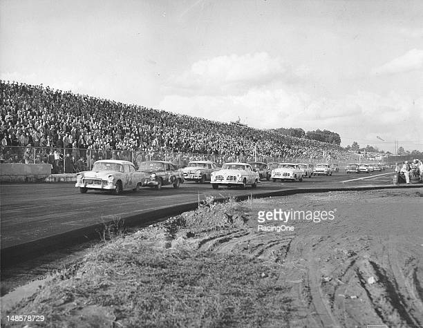 Herb Thomas in a Chevrolet grabs the early lead rom fellow Chevrolet driver Gwyn Staley at the start of the NASCAR Cup race at Martinsville Speedway