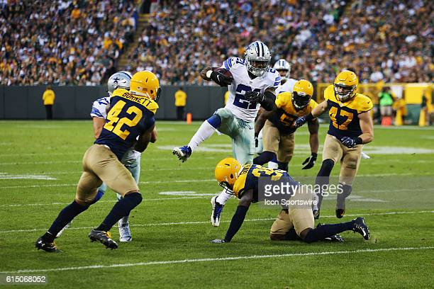 Dallas Cowboys Running Back Ezekiel Elliott hurdles a defender during the Dallas Cowboys 3016 victory over the Green Bay Packers at Lambeau Field in...
