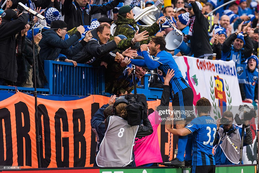 Montreal Impact Midfielder Ignacio Piatti (19) celebrating his second goal of the game with the crowd during the Toronto FC versus the Montreal Impact game at Stade Saputo in Montreal, QC