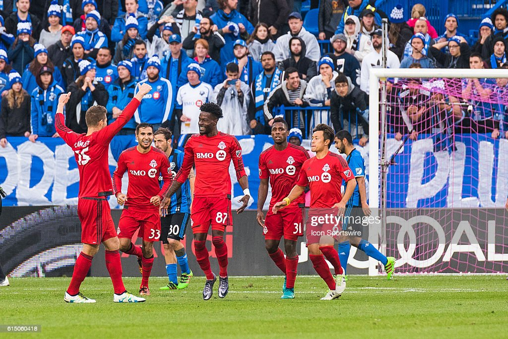 Toronto players celebrating =i87=goal making the score 2-2 during the Toronto FC versus the Montreal Impact game at Stade Saputo in Montreal, QC