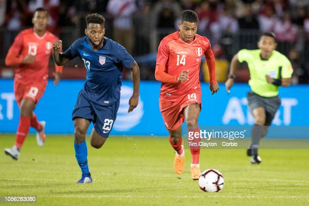 Andy Polo of Peru challenged by midfielder Kellyn Acosta of the United States during the United States Vs Peru International Friendly soccer match at...