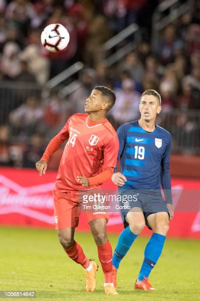 Andy Polo of Peru defended by Ben Sweat of the United States during the United States Vs Peru International Friendly soccer match at Pratt Whitney...