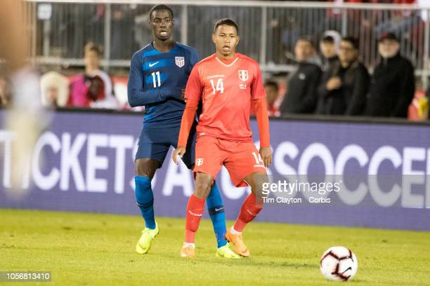 Andy Polo of Peru defended by Tim Weah of the United States during the United States Vs Peru International Friendly soccer match at Pratt Whitney...