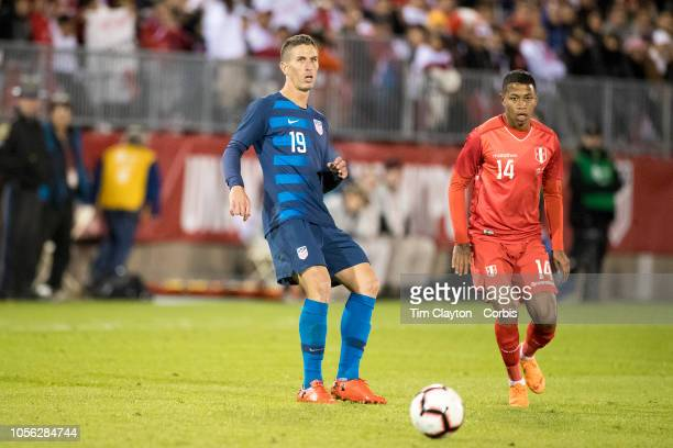 Ben Sweat of the United States defended by forward Andy Polo of Peru during the United States Vs Peru International Friendly soccer match at Pratt...