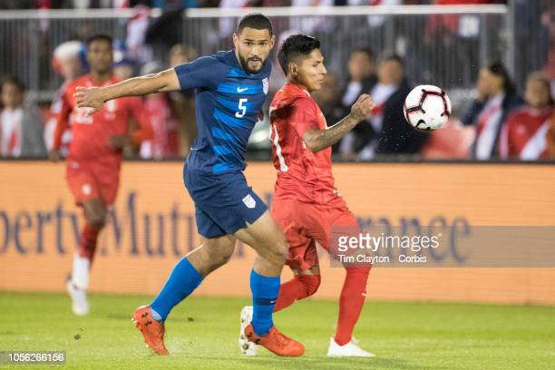 Cameron CarterVickers of the United States defends against forward Raul Ruidiaz of Peru during the United States Vs Peru International Friendly...