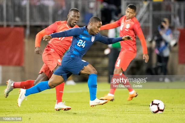 Jonathan Amon of the United States defended by Luis Advincula of Peru during the United States Vs Peru International Friendly soccer match at Pratt...