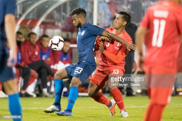 Kellyn Acosta of the United States defended by midfielder Renato Tapia of Peru during the United States Vs Peru International Friendly soccer match...