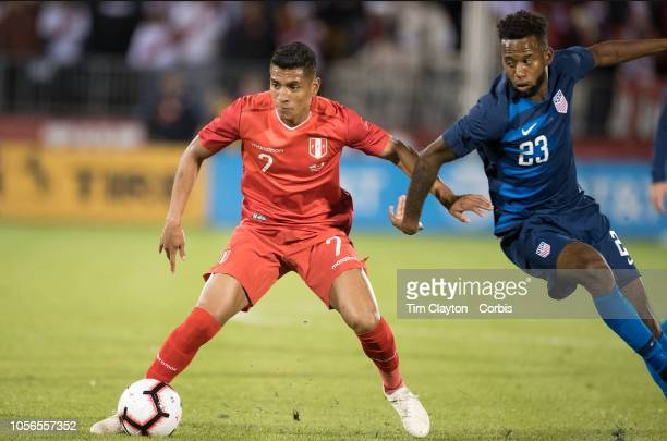 Luis Advincula of Peru challenged by Kellyn Acosta of the United States in action during the United States Vs Peru International Friendly soccer...