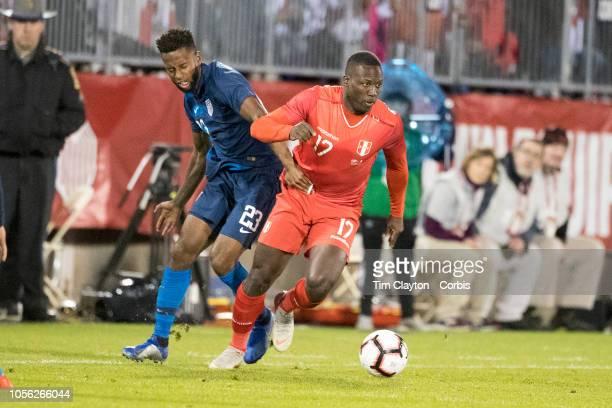 Luis Advincula of Peru defended by Kellyn Acosta of the United States during the United States Vs Peru International Friendly soccer match at Pratt...