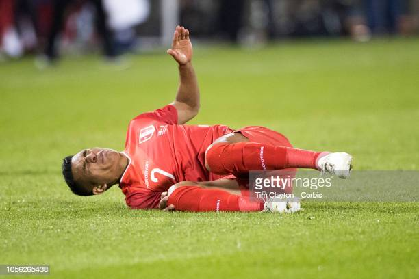 Luis Advincula of Peru reacts after taking a knock to the knee during the United States Vs Peru International Friendly soccer match at Pratt Whitney...