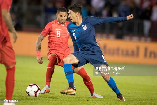 Marky Delgado of the United States defended by midfielder Sergio Pena of Peru during the United States Vs Peru International Friendly soccer match at...