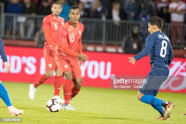 Renato Tapia of Peru defended by Marky Delgado of the United States in action during the United States Vs Peru International Friendly soccer match at...