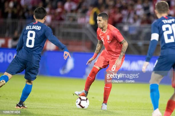 Sergio Pena of Peru defended by midfielder Marky Delgado of the United States during the United States Vs Peru International Friendly soccer match at...