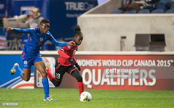 Haiti's Roselord Borgella challenges Trinidad and Tobago's Kennya Cordner during the CANCACAF Woman's Championship game between Haiti and Trinidad...