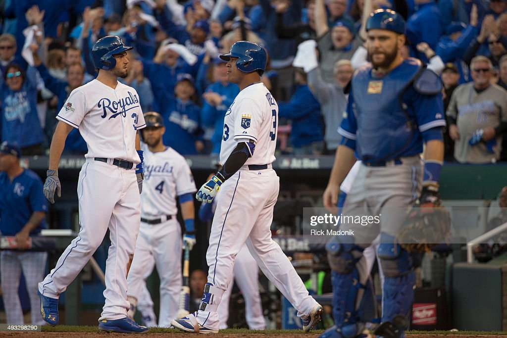 October 17, 2015 - Kansas City Royals Eric Hosmer (left) and Salvador Perez celebrate the runs scored as Blue Jays catcher Russell Martin looks back to the infield. Toronto Blue Jays V Kansas City Royals in Game 2 of the American League Championship Series in MLB action at Kauffman Field. Jays lose Game 2 6-3 and go down 0-2 in the series. Toronto Star/Rick Madonik
