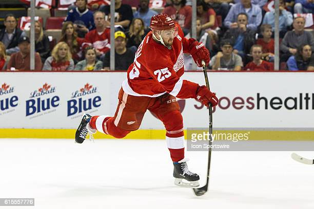 Detroit Red Wings defenseman Mike Green fires a slapshot on goal during the regular season home opener NHL hockey game between the Ottawa Senators...