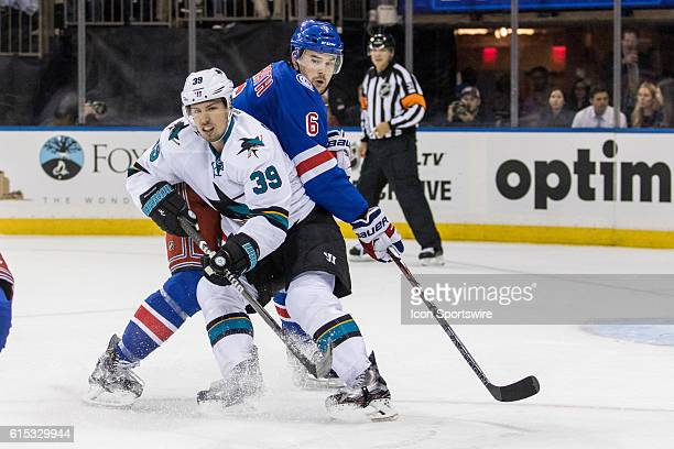 New York Rangers Defenseman Dylan McIlrath reaches around San Jose Sharks Center Logan Couture during the first period of a NHL game between the San...