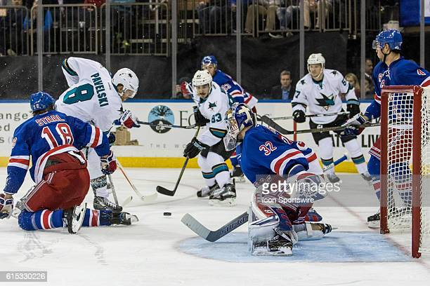New York Rangers Defenseman Marc Staal gets a stick in front of San Jose Sharks Center Joe Pavelski in front of the net during the third period of a...