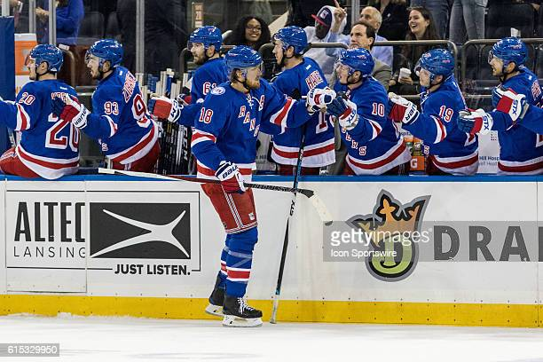 New York Rangers Defenseman Marc Staal works his way down the Rangers bench after scoring in the first period of a NHL game between the San Jose...