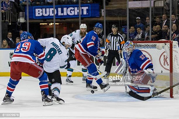 New York Rangers Right Wing Jesper Fast gets called for hooking as San Jose Sharks Center Joe Pavelski takes a shot on goal during the first period...