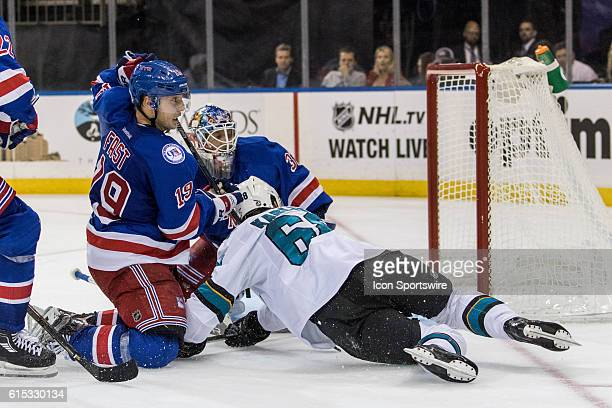 New York Rangers Right Wing Jesper Fast takes down San Jose Sharks Right Wing Melker Karlsson in front of the net during the third period of a NHL...