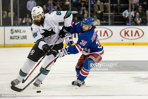 New York Rangers Right Wing Mats Zuccarello reaches in on San Jose Sharks Defenseman Brent Burns during the third period of a NHL game between the...