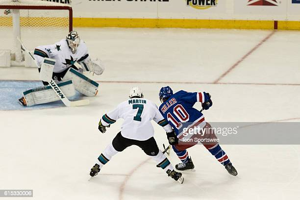 San Jose Sharks Defenseman Paul Martin leans on New York Rangers Center JT Miller to keep Miller from crossing in front of San Jose Sharks Goalie...