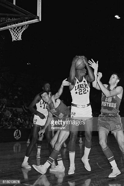 October 18 1959Minneapolis Minnesota Minneapolis Lakers' Elgin Baylor grabs a rebound off Detroit's board during the first half of the NBA opener...