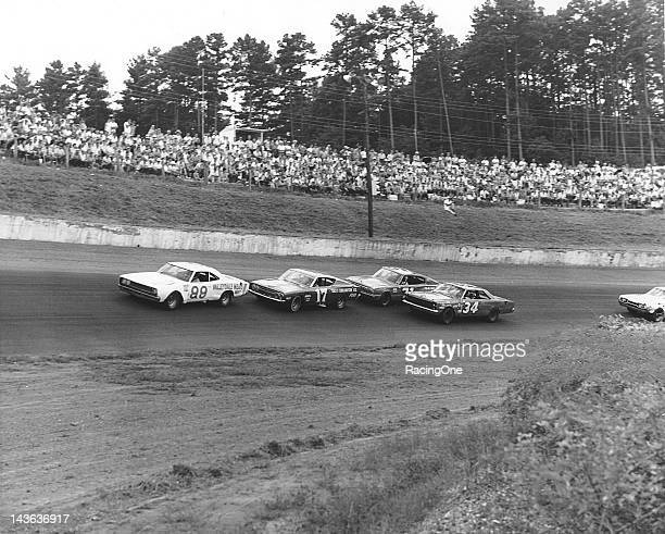 October 18, 1968: Paul Goldsmith leads David Pearson and Bobby Isaac as they lap Wendell Scott during the Western North Carolina 500 NASCAR Cup race...