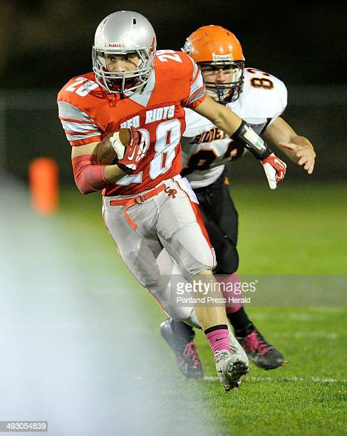 October 18 2013ë¦ South Portland vs Biddeford football game South Portland's Joey DiBiase gets some running room after getting outside of...