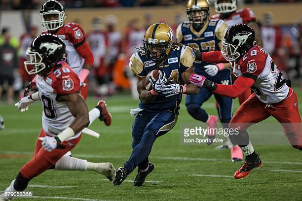 Bombers Paris Cotton breaks a long run during the Calgary Stampeders vs Bombers game at the Investors Group Field in Winnipeg MB.
