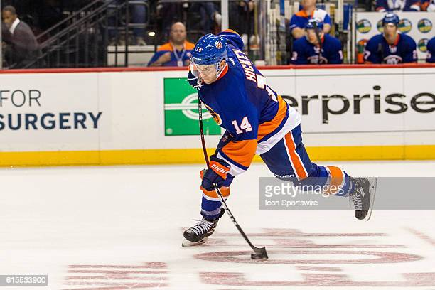 New York Islanders Denfenseman Thomas Hickey takes a shot on goal during the second period of a NHL game between the San Jose Sharks and the New York...