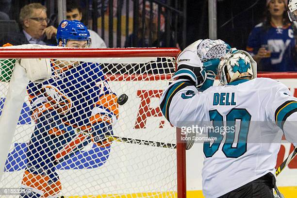 New York Islanders Left Wing Anthony Beauvillier peers through the net to see the puck slip past San Jose Sharks Goalie Aaron Dell scoring his first...