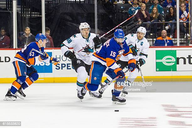 New York Islanders Right Wing Cal Clutterbuck works to clear the puck out of the Islanders zone during the first period of a NHL game between the San...