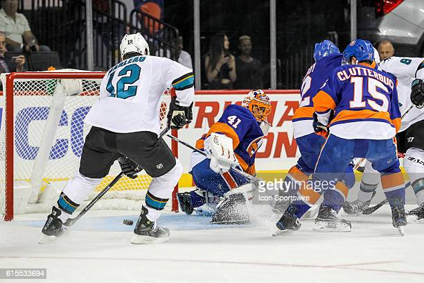 San Jose Sharks Center Patrick Marleau misses an opportunity as a rebound off of New York Islanders Goalie Jaroslav Halak skips between his legs...