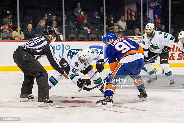 San Jose Sharks Right Wing Joel Ward and New York Islanders Center John Tavares face off during the first period of a NHL game between the San Jose...