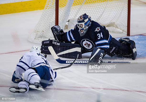 Jets Michael Hutchinson stops Leafs Mitch Marner during the Winnipeg Jets vs Toronto Maple Leafs game at the MTS Centre in Winnipeg MB