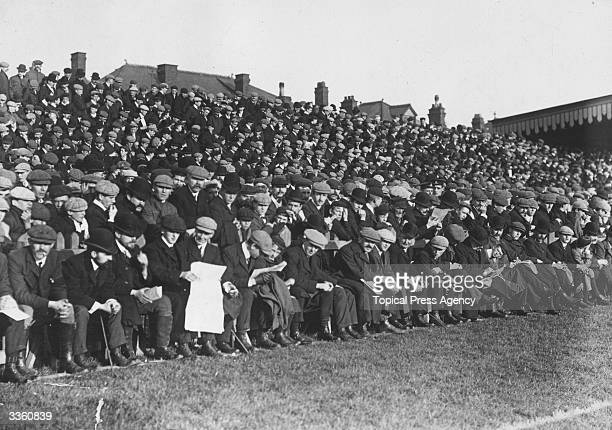 Spectators on a pavilion bordering Newport rugby pitch during a match between Newport and South Africa.