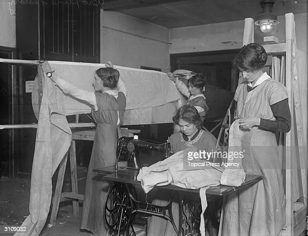 A group of skilled seamstresses work on the fabric which is to become the wings of the Whitehead aircraft