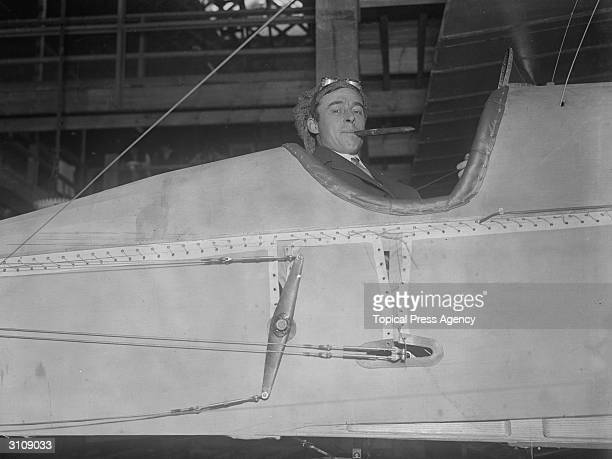 Mr J A Whitehead displaying one of his new planes while in production on the factory line