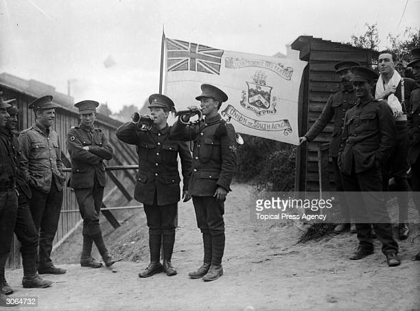 South African soldiers stationed at Bexhill blowing the bugle during team games