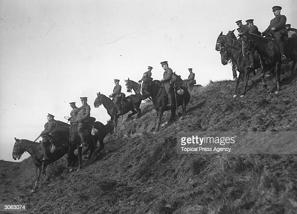 The Canadian cavalry undergo training at Shorncliffe during World War I riding down the steep slope of a hill