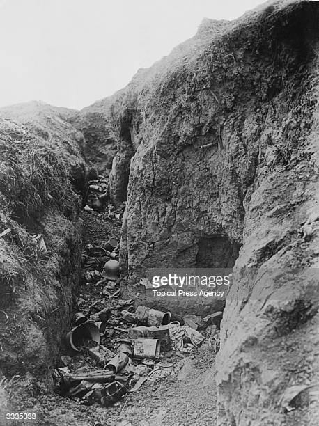 A deserted German trench on the Somme littered with personal remains and empty tins