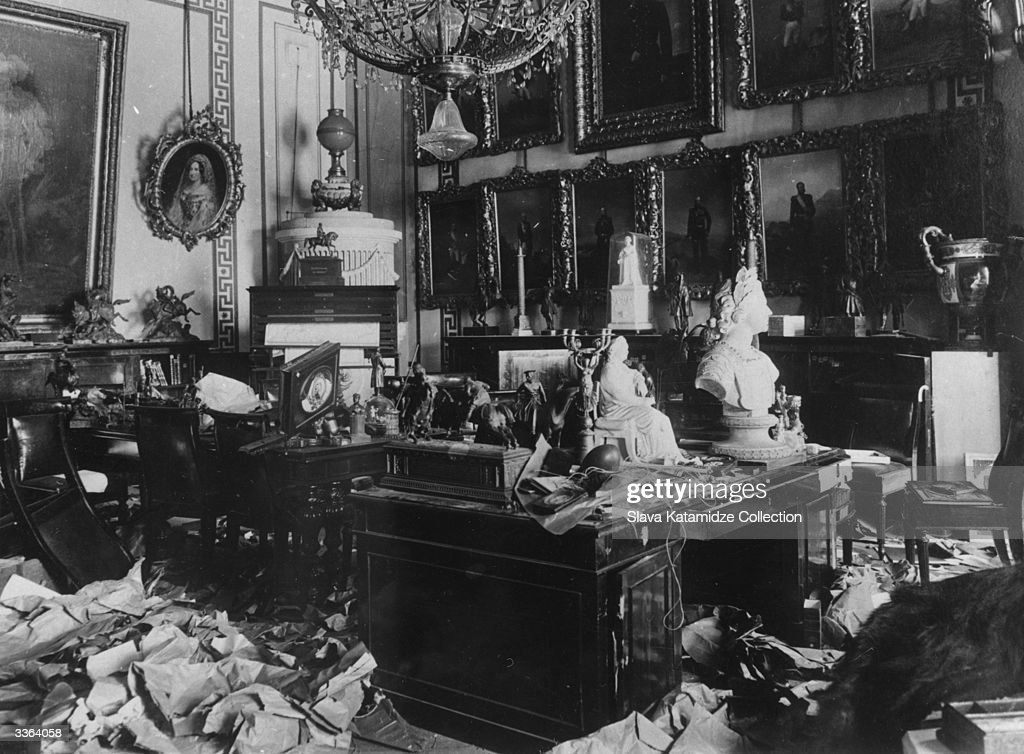 A ransacked room in the Tsar's Winter Palace, Petrograd (St Petersburg), after suffering damage at the hands of Bolshevik troops in the Russian Revolution. The whole room is in disarray and broken works of art lie among the debris.