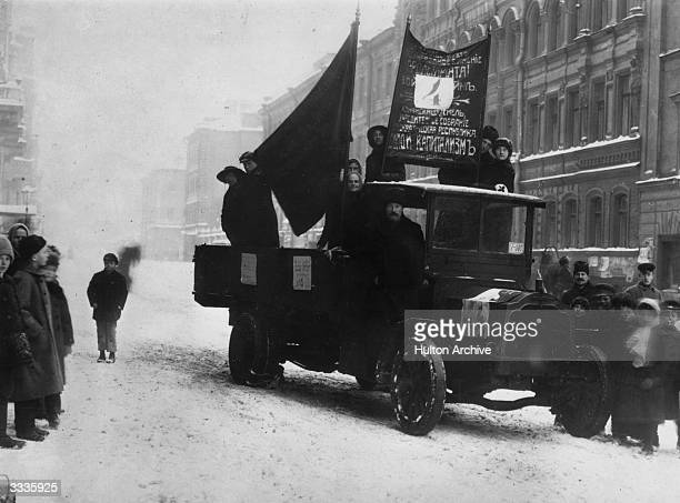 A truck carries Bolsheviks canvassing for the Constituent Assembly during the Russian Revolution
